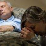 ill man with oxygen and woman by his bedside Queener Law