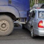 semi truck hits a compact car Queener Law