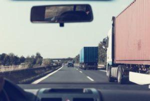 semi trucks on busy highway Queener Law