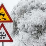 slippery snowy warning signs on road Queener Law