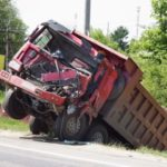 semi truck in a ditch with bed of truck totaled Queener Law
