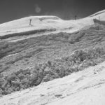 black and white photo of snow on hill Queener Law