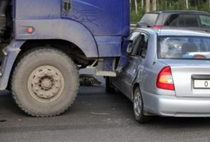 semi truck t-boned compact car Queener Law