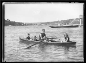 dad two kids and dog in canoe Queener Law