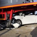 white car ends up under truck bed Queener Law