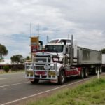 semi truck with several trailers Queener Law