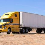 large semi truck on desert highway Queener Law