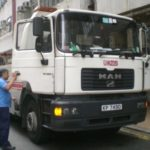 small work truck in another country Queener Law
